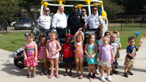Officers from left: Ofc. James Poe; Chief Scott Jones; Sgt. James Joseph; Cpl. Clifton Brown; Cpl. Chad Dupuy; In front: students of Livingston Head Start Program;